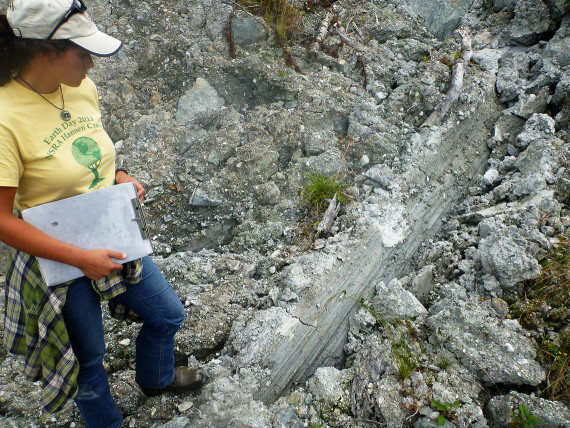 Ecologist Anna Mostovetsky inspects the lateral margin of a large deep-seated landslide. Landslide prevention and mitigation is an important aspect of watershed recovery on forest lands.