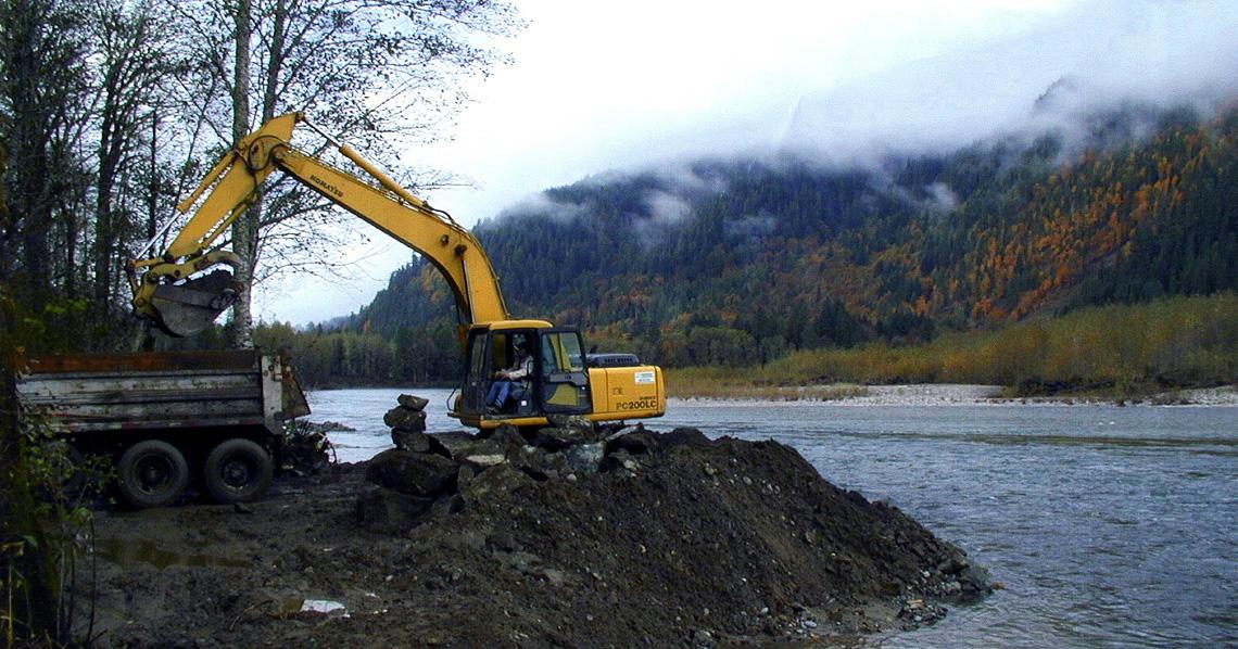 Downstream view of equipment removing rip-rap during Phase 2.  Photo: John Klochak
