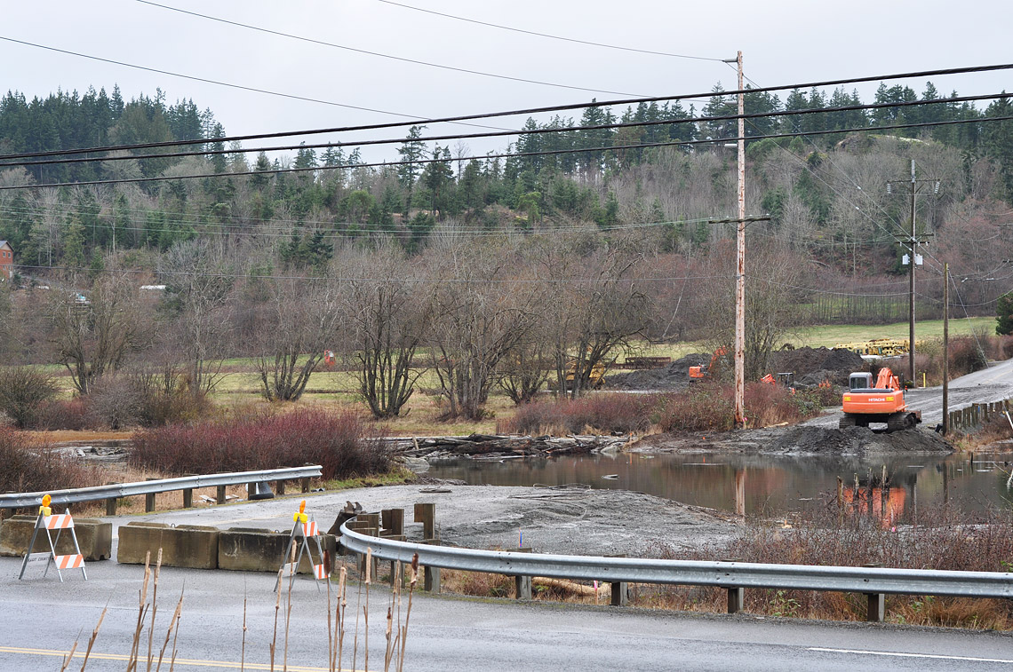 An incoming high tide across the former road prism just after removal of the Similk Bay Road crossing.